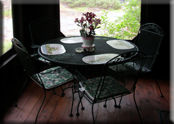 Table and chairs on screened porch
